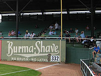 Throwback ads adorn the outfield walls of Birmingham's throwback ballpark