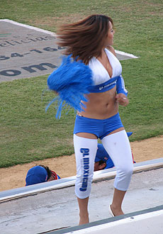 The Tijuana Potros cheerleaders dance on top of the dugout